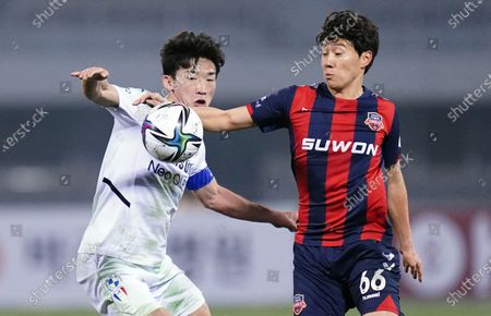 Kim Min-Woo of Suwon Samsung Bluewings competes for the ball with Han Seung-Gyu of Suwon FC during 2021 K League 1 match between Suwon FC and Suwon Samsung Bluewings at Suwon Sports Complex in Suwon, South Korea, on March 10, 2021.