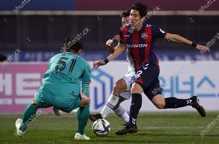 Stock Picture of Kim Min-Woo of Suwon Samsung Bluewings competes for the ball with Yun Young-sun of Suwon FC during2021 K League 1 match between Suwon FC and Suwon Samsung Bluewings at Suwon Sports Complex in Suwon, South Korea, on March 10, 2021.