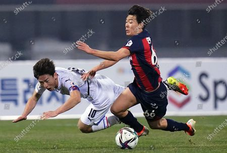Stock Photo of Kim Min-Woo of Suwon Samsung Bluewings competes for the ball with Han Seung-Gyu of Suwon FC during 2021 K League 1 match between Suwon FC and Suwon Samsung Bluewings at Suwon Sports Complex in Suwon, South Korea, on March 10, 2021.