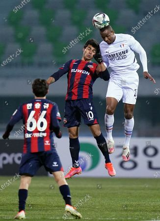 Murilo Henrique Pereira Rocha of Suwon FC and Yang Hyung-Mo of Suwon Samsung Bluewings duel for the ball in the air during 2021 K League 1 match between Suwon FC and Suwon Samsung Bluewings at Suwon Sports Complex in Suwon, South Korea, on March 10, 2021.