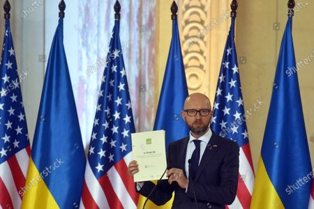 Stock Photo of Former Ukrainian prime minister (2014-2016), char of the Kyiv Security Forum Arseniy Yatsenyuk is pictured during the presentation of the Twelve Points to Strengthen the Strategic Partnership between the United States and Ukraine (the joint address by Ukrainian and American public figures), Kyiv, capital of Ukraine.