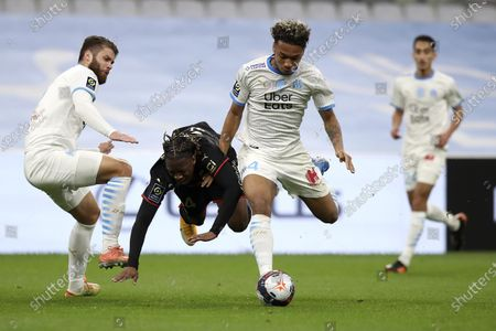 Rennes' Brandon Soppy, center, fights for the ball with Marseille's Boubacar Kamara, right, and Duje Caleta-Car, left, during the French League One soccer match between Marseille and Rennes at the Stade Velodrome in Marseille, southern France