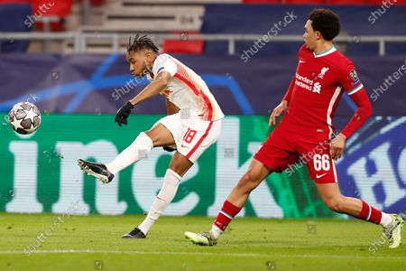 Leipzig's Christopher Nkunku, left, is challenged by Liverpool's Trent Alexander-Arnold during the Champions League round of 16 second leg soccer match between Liverpool and RB Leipzig at the Puskas Arena stadium in Budapest, Hungary