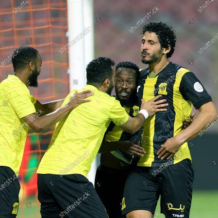 Al-Ittihad's player Fahad Al Muwallad (2-R) celebrates after scoring a goal with teammate Ahmed Hegazy (R) during the Saudi Professional League soccer match between Al-Ittihad and Al-Shabab at King Abdulaziz Stadium, in Mecca, Saudi Arabia, 10 March 2021.