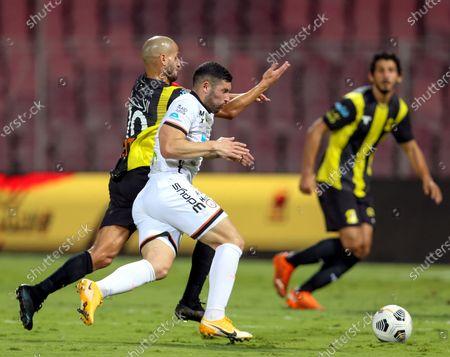 Al-Ittihad's player Karim El Ahmadi (back) in action against Al-Shabab's Cristian Guanca (front) during the Saudi Professional League soccer match between Al-Ittihad and Al-Shabab at King Abdulaziz Stadium, in Mecca, Saudi Arabia, 10 March 2021.