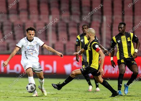Al-Ittihad's player Karim El Ahmadi (2-R) in action against Al-Shabab's Turki Al Ammar (L) during the Saudi Professional League soccer match between Al-Ittihad and Al-Shabab at King Abdulaziz Stadium, in Mecca, Saudi Arabia, 10 March 2021.