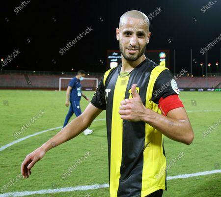 Stock Photo of Al-Ittihad's player Karim El Ahmadi gives a thumbs up after winning (2-1) the Saudi Professional League soccer match between Al-Ittihad and Al-Shabab at King Abdulaziz Stadium, in Mecca, Saudi Arabia, 10 March 2021.