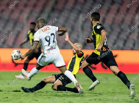 Al-Ittihad's player Karim El Ahmadi (down) in action against Al-Shabab's Seba (L) during the Saudi Professional League soccer match between Al-Ittihad and Al-Shabab at King Abdulaziz Stadium, in Mecca, Saudi Arabia, 10 March 2021.