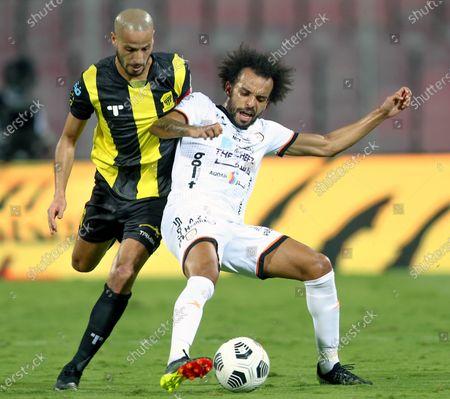 Al-Ittihad's player Karim El Ahmadi (L) in action against Al-Shabab's Fabio Martins (R) during the Saudi Professional League soccer match between Al-Ittihad and Al-Shabab at King Abdulaziz Stadium, in Mecca, Saudi Arabia, 10 March 2021.