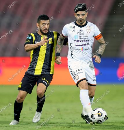 Stock Picture of Al-Ittihad's player Abdulelah Al Malki (L) in action against Al-Shabab's Ever Banega (R) during the Saudi Professional League soccer match between Al-Ittihad and Al-Shabab at King Abdulaziz Stadium, in Mecca, Saudi Arabia, 10 March 2021.