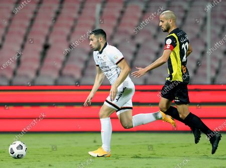 Al-Ittihad's player Karim El Ahmadi (R) in action against Al-Shabab's Cristian Guanca (L) during the Saudi Professional League soccer match between Al-Ittihad and Al-Shabab at King Abdulaziz Stadium, in Mecca, Saudi Arabia, 10 March 2021.