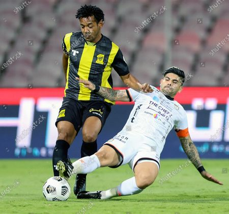 Al-Ittihad's player Romarinho (L) in action against Al-Shabab's Ever Banega (R) during the Saudi Professional League soccer match between Al-Ittihad and Al-Shabab at King Abdulaziz Stadium, in Mecca, Saudi Arabia, 10 March 2021.