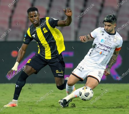Stock Image of Al-Ittihad's player Haroune Camara (L) in action against Al-Shabab's Ever Banega (R) during the Saudi Professional League soccer match between Al-Ittihad and Al-Shabab at King Abdulaziz Stadium, in Mecca, Saudi Arabia, 10 March 2021.