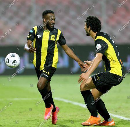 Al-Ittihad's player Fahad Al Muwallad (L) celebrates after scoring a goal with teammate Ahmed Hegazy (R) during the Saudi Professional League soccer match between Al-Ittihad and Al-Shabab at King Abdulaziz Stadium, in Mecca, Saudi Arabia, 10 March 2021.