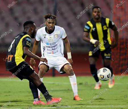Al-Ittihad's player Fahad Al Muwallad (L) in action against Al-Shabab's Fawaz Al-Sagour (2-L) during the Saudi Professional League soccer match between Al-Ittihad and Al-Shabab at King Abdulaziz Stadium, in Mecca, Saudi Arabia, 10 March 2021.