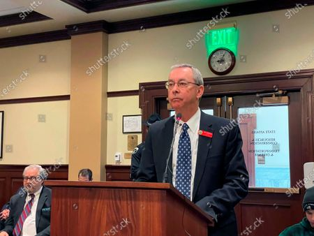 Idaho Lottery Director Jeff Anderson addresses the House State Affairs Committee at the Statehouse in Boise, Idaho on . The panel killed legislation that would have allowed the Powerball game with multi-million dollar jackpots to continue in the state