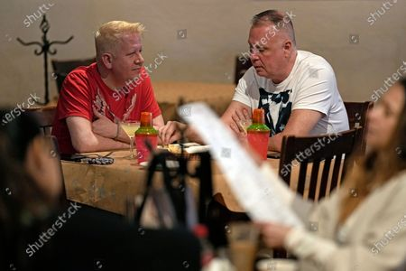 Brandon Blanton, left, and Russell Hicks, right, eat lunch at Picos Mexican restaurant, in Houston. Picos, like many restaurants across the state, continue to operate at a reduced capacity and ask customers to wear masks despite Texas Gov. Greg Abbott ending state mandates for COVID-19 safety measures Wednesday