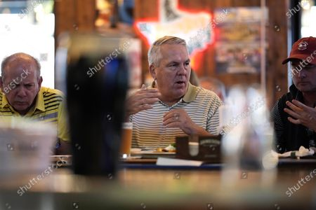 Customers eat at the bar inside Mo's Irish Pub, in Houston. Texas Gov. Greg Abbott allowed the state mandates for COVID-19 safety measures to expire Wednesday