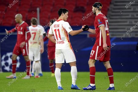 Hwang Hee-chan (L) of RB Leipzig shakes hands with Nathaniel Phillips of Liverpool after the UEFA Champions League round of 16, second leg, soccer match between Liverpool FC and RB Leipzig at Puskas Ferenc Arena in Budapest, Hungary, 10 March 2021.