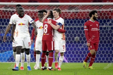 Marcel Sabitzer (2-R) of RB Leipzig and Naby Keita (C) of Liverpool react after the UEFA Champions League round of 16, second leg, soccer match between Liverpool FC and RB Leipzig at Puskas Ferenc Arena in Budapest, Hungary, 10 March 2021.