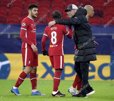 Naby Keita (C) of Liverpool and Juergen Klopp, head coach of Liverpool (R) react after the UEFA Champions League round of 16, second leg, soccer match between Liverpool FC and RB Leipzig at Puskas Ferenc Arena in Budapest, Hungary, 10 March 2021.