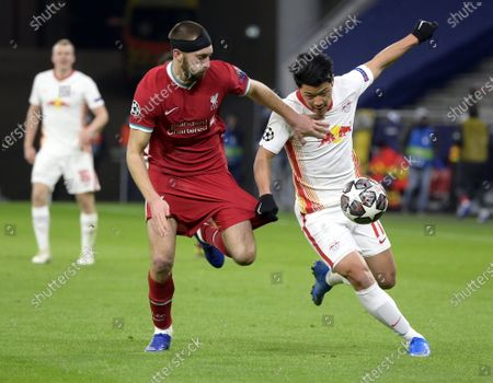 Hwang Hee-chan (R) of RB Leipzig fights for the ball with Nathaniel Phillips of Liverpool during the UEFA Champions League round of 16, second leg, soccer match between Liverpool FC and RB Leipzig at Puskas Ferenc Arena in Budapest, Hungary, 10 March 2021.