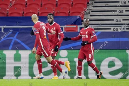 (L-R) Liverpool's Fabinho, Divock Origi and Naby Keita celebrate during the UEFA Champions League round of 16, second leg, soccer match between Liverpool FC and RB Leipzig at Puskas Ferenc Arena in Budapest, Hungary, 10 March 2021.