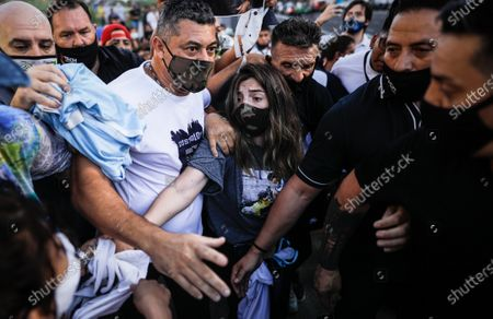 Stock Picture of Dalma Maradona, daughter of Diego Armando Maradona, takes part in a demonstration to demand justice for the death of the Argentine star, in downtown Buenos Aires, Argentina, 10 March 2021. Supporters and relatives of former Argentine footballer Diego Armando Maradona demonstrate in downtown Buenos Aires to demand justice for the death of the idol, which is the subject of an investigation to determine if there was any negligence around his medical care.