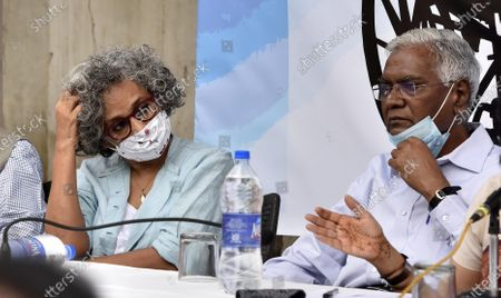 ( R- L)  CPI leader D Raja, and Writer Arundhati Roy jointly address press conference demanding the release of GN Saibaba at Press Club on March 10, 2021 in New Delhi, India. Former Delhi University professor G N Saibaba is serving a life term in Nagpur Central Prison for alleged Maoist links, on medical grounds. Saibaba, who is wheelchair-bound with over 90 per cent physical disability, had tested positive for COVID-19 on February 12.