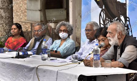 ( R- L)  Association of Democratic Rights activist Parminder Singh, Former DUTA President Nandita Narain, CPI leader D Raja, Writer Arundhati Roy, National Platform for the Right of Disabled Murlidharan, and Vasantha Wife of GN Saibaba and Women's Rights Activists jointly address press conference demanding the release of GN Saibaba at Press Club on March 10, 2021 in New Delhi, India. Former Delhi University professor G N Saibaba is serving a life term in Nagpur Central Prison for alleged Maoist links, on medical grounds. Saibaba, who is wheelchair-bound with over 90 per cent physical disability, had tested positive for COVID-19 on February 12.