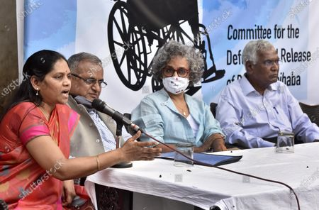 ( R- L)  CPI leader D Raja, Writer Arundhati Roy, National Platform for the Right of Disabled Murlidharan, and Vasantha Wife of GN Saibaba and Women's Rights Activists jointly address press conference demanding the release of GN Saibaba at Press Club on March 10, 2021 in New Delhi, India. Former Delhi University professor G N Saibaba is serving a life term in Nagpur Central Prison for alleged Maoist links, on medical grounds. Saibaba, who is wheelchair-bound with over 90 per cent physical disability, had tested positive for COVID-19 on February 12.