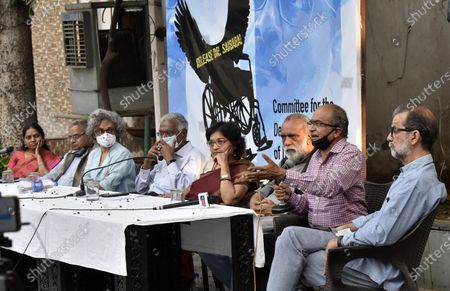 ( R- L)  Filmmaker Sanjay Kak, Senior Advocate Prashant Bhushan, Association of Democratic Rights activist Parminder Singh, Former DUTA President Nandita Narain, CPI leader D Raja, Writer Arundhati Roy, National Platform for the Right of Disabled Murlidharan, and Vasantha Wife of GN Saibaba and Women's Rights Activists jointly address press conference demanding the release of GN Saibaba at Press Club on March 10, 2021 in New Delhi, India. Former Delhi University professor G N Saibaba is serving a life term in Nagpur Central Prison for alleged Maoist links, on medical grounds. Saibaba, who is wheelchair-bound with over 90 per cent physical disability, had tested positive for COVID-19 on February 12.