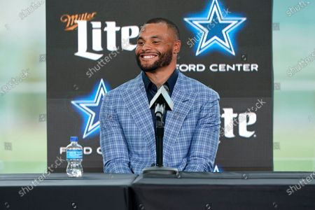Dallas Cowboys quarterback Dak Prescott smiles during a news conference at the team's NFL football practice facility in Frisco, Texas, . The Cowboys and Prescott have finally agreed on the richest contract in club history, two years after negotiations began with the star quarterback