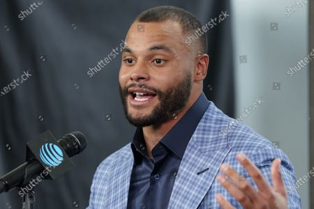 Dallas Cowboys quarterback Dak Prescott speaks during a news conference at the team's NFL football practice facility in Frisco, Texas, . The Cowboys and Prescott have finally agreed on the richest contract in club history, two years after negotiations began with the star quarterback