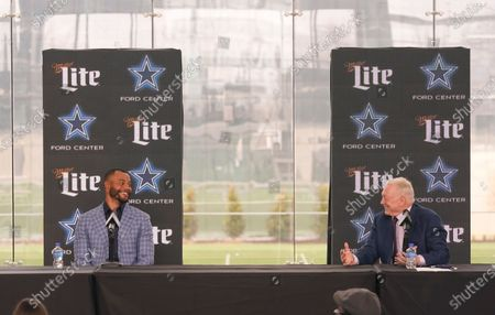 Dallas Cowboys quarterback Dak Prescott, left, and team owner Jerry Jones smile and look at each other during a news conference at the team's NFL football practice facility in Frisco, Texas, . The Cowboys and Prescott have finally agreed on the richest contract in club history, two years after negotiations began with the star quarterback