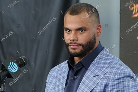 Dallas Cowboys quarterback Dak Prescott listens to a question during a news conference at the team's NFL football practice facility in Frisco, Texas, . The Cowboys and Prescott have finally agreed on the richest contract in club history, two years after negotiations began with the star quarterback