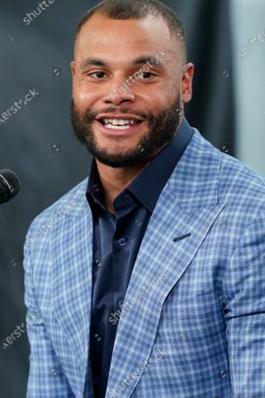 Dallas Cowboys quarterback Dak Prescott answers a question during a news conference at the team's NFL football practice facility in Frisco, Texas, . The Cowboys and Prescott have finally agreed on the richest contract in club history, two years after negotiations began with the star quarterback