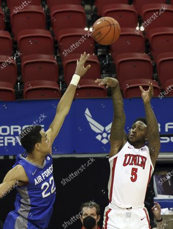 Guard David Jenkins Jr. (5) shoots over Air Force forward Nikc Jackson (22) during the second half of an NCAA college basketball game in the first round of the Mountain West Conference tournament, in Las Vegas