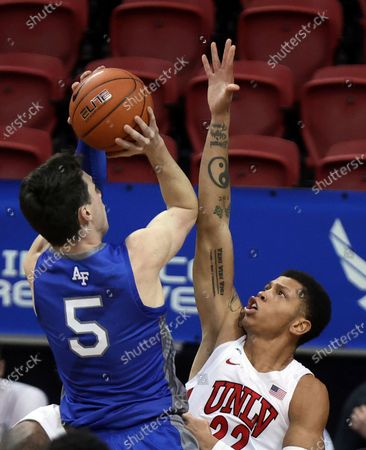 Air Force guard Chris Joyce (5) shoots as UNLV guard Nicquel Blake (22) defends during the second half of an NCAA college basketball game in the first round of the Mountain West Conference men's tournament, in Las Vegas