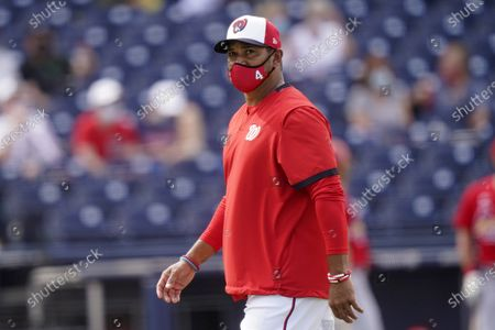 Washington Nationals manager Dave Martinez walks to the dugout after a pitching change during a spring training baseball game against the St. Louis Cardinals, in West Palm Beach, Fla