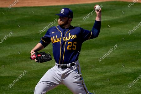 Milwaukee Brewers starting pitcher Brett Anderson throws during the first inning of a spring training baseball game against the Oakland Athletics, in Mesa, Ariz