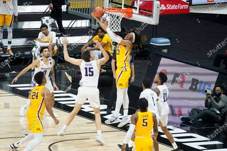 Minnesota's Brandon Johnson (23) puts up a shot against Northwestern's Ryan Young (15) during the second half of an NCAA college basketball game at the Big Ten Conference tournament, in Indianapolis. Minnesota won 51-46