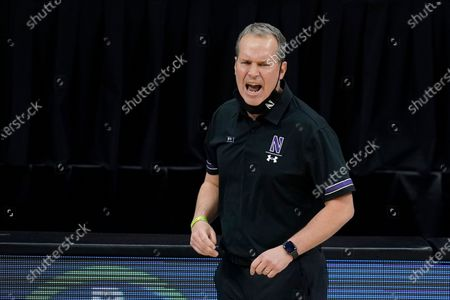 Stock Photo of Northwestern head coach Chris Collins watches during the second half of an NCAA college basketball game against Minnesota at the Big Ten Conference tournament, in Indianapolis