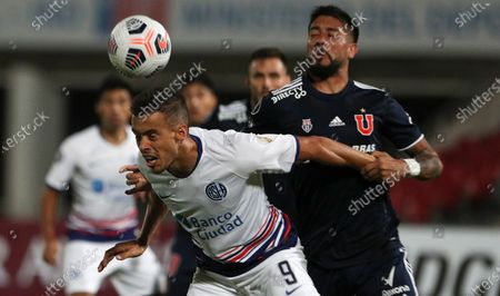 Stock Picture of Franco Di Santo of Argentina's San Lorenzo, left, and Ramon Arias of Universidad de Chile battle for the ball during a Copa Libertadores soccer match in Santiago, Chile