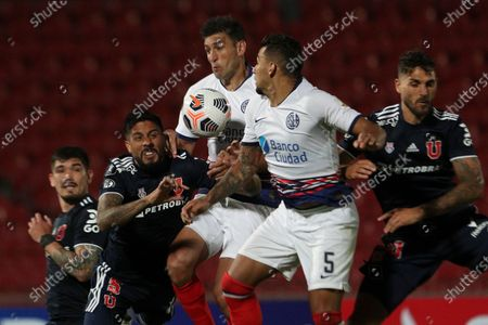 Diego Braghieri, center left, and Yeison Vargas, center right, of Argentina's San Lorenzo fight for the ball with Ramon Arias of Universidad de Chile during a Copa Libertadores soccer match in Santiago, Chile