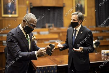 Tony Blinken, U.S. secretary of state, (R) speaks with Representative Gregory Meeks, a Democrat from New York, and chairman of the House Foreign Affairs Committee, after the conclusion of a House Foreign Affairs Committee hearing in Washington, DC on Wednesday, March 10, 2021. The Biden administration is considering withdrawing all troops from Afghanistan by May 1 as it leans on President Ashraf Ghani to accelerate peace talks with the Taliban, including by supporting a proposal for six-nation discussions that include Iran.
