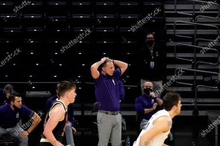 Northwestern head coach Chris Collins reacts as he watches his team during the second half of an NCAA college basketball game against Nebraska in Evanston, Ill., . Northwestern won 79-78