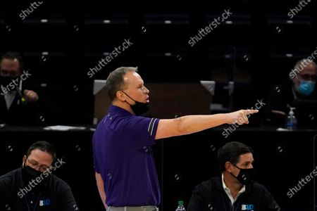 Northwestern head coach Chris Collins points as he calls his team during the second half of an NCAA college basketball game against Nebraska in Evanston, Ill., . Northwestern won 79-78