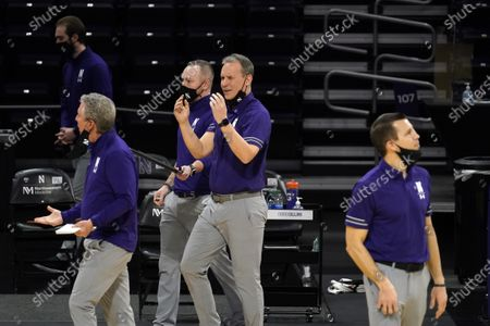 Northwestern head coach Chris Collins, center, reacts as he watches his team during the second half of an NCAA college basketball game against Nebraska in Evanston, Ill., . Northwestern won 79-78