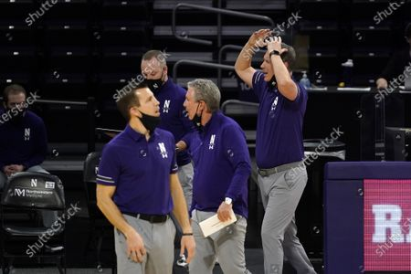 Northwestern head coach Chris Collins, right, reacts as he watches his team during the second half of an NCAA college basketball game against Nebraska in Evanston, Ill., . Northwestern won 79-78